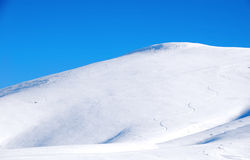 Seasonal snowy mountain peaks. Winter season landscape with snowy slopes Royalty Free Stock Photography