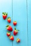 Seasonal strawberries on blue wooden background Stock Photo