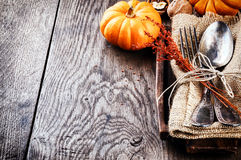 Seasonal table setting with small pumpkins. And autumn decoration Stock Images