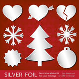 Seasonal tags. Winter holidays foil elements set Royalty Free Stock Photos