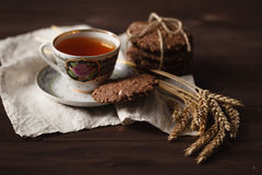 Seasonal tea at evening with oat cookies Royalty Free Stock Photo