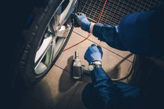 Seasonal Tire Replacement. Car Service Worker Replacing Vehicle Tires and Rotate the Wheels Stock Image