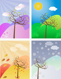 Seasonal trees set. Vector image of four seasonal trees with proper backgrounds Stock Images