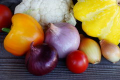Seasonal vegetables: cauliflower, squash, bell peppers, onions and tomatoes Stock Photo
