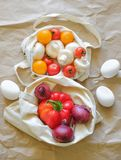 Seasonal vegetables and eggs are in eco bags stock photos