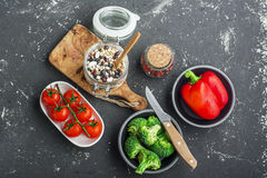 Seasonal vegetables and herbs.Vegetarian, clean eating and super food concept ingredients . Dinner table with cereals Stock Photo