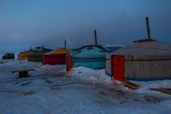 Seasonal village of yurts for fishermen on the ice in the Lake Baikal. Royalty Free Stock Photo