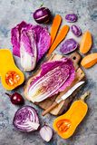 Seasonal winter autumn fall vegetables over gray stone table. Plant based vegan or vegetarian cooking concept. Clean eating food. Seasonal winter autumn fall stock photo