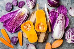 Seasonal winter autumn fall vegetables over gray stone table. Plant based vegan or vegetarian cooking concept. Clean eating food. Alkaline diet stock photography