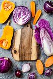 Seasonal winter autumn fall vegetables over gray stone table. Plant based vegan or vegetarian cooking concept. Clean eating food. Alkaline diet stock image