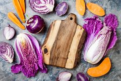 Seasonal winter autumn fall vegetables over gray stone table. Plant based vegan or vegetarian cooking concept. Clean eating food. Alkaline diet royalty free stock photos