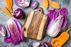 Seasonal winter autumn fall vegetables over gray stone table. Plant based vegan or vegetarian cooking concept. Clean eating food. Alkaline diet royalty free stock images