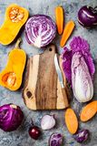 Seasonal winter autumn fall vegetables over gray stone table. Plant based vegan or vegetarian cooking concept. Clean eating food. Alkaline diet stock photos