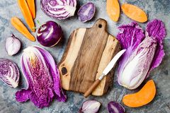 Seasonal winter autumn fall vegetables over gray stone table. Plant based vegan or vegetarian cooking concept. Clean eating food. Alkaline diet royalty free stock photography