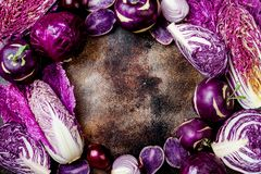 Seasonal winter autumn purple vegetables background. Plant based vegan or vegetarian cooking concept. Clean eating food. Seasonal winter autumn purple vegetables stock photography