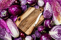 Seasonal winter autumn purple vegetables background. Plant based vegan or vegetarian cooking concept. Clean eating food. Alkaline diet stock photography