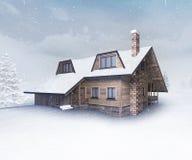 Seasonal wooden cottage at winter snowfall Royalty Free Stock Image