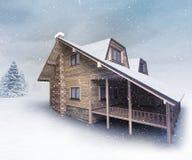 Seasonal wooden lodge at winter snowfall Stock Photography