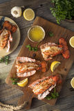Seasoned Baked Lobster Tails. With Lemon and Butter Sauce Stock Images