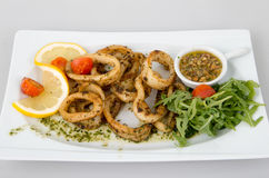 Seasoned calamari with lemon Stock Photography