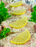 Seasoned Chicken. Breasts with lemon slices stock images