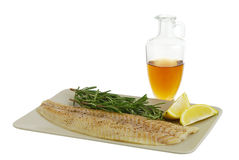 Seasoned fish  fillet with healthy ingredients Royalty Free Stock Photography