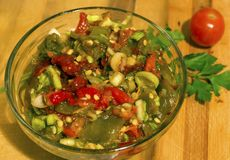 Salad of roasted red and green peppers. royalty free stock photography