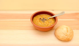 Seasoned lentil soup with a crusty bread roll Stock Image