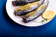 Seasoned mackerel with lemon Royalty Free Stock Photos