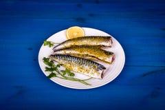 Seasoned mackerel with lemon Royalty Free Stock Photo