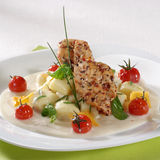 Seasoned Meat, Gnocchi And Cheese Sauce Royalty Free Stock Image