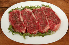 Seasoned New York strips Stock Photos