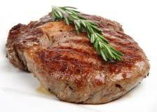 Seasoned Rib-Eye Beef Steak. Juicy rib-eye steak resting after being griddled Stock Image