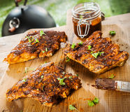 Seasoned ribs on a picnic table at a BBQ Royalty Free Stock Photo