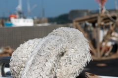 Seasoned rope on boat deck in harbor stock images