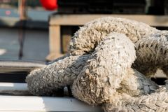 Seasoned rope on boat deck stock images
