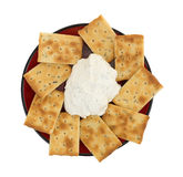 Seasoned rosemary and olive oil crackers with dip Stock Photography
