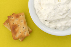 Seasoned rosemary and olive oil crackers with dip Royalty Free Stock Image