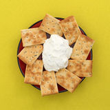 Seasoned rosemary and olive oil crackers with dip Stock Photo