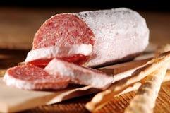 Seasoned salami on wood Royalty Free Stock Image