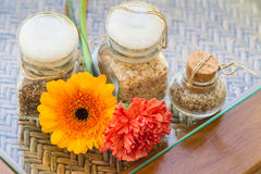 Seasoned salt and flowers from above Stock Image