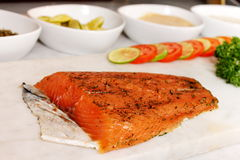 Seasoned smoked salmon with lemon slices Stock Images