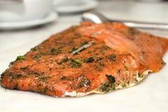 Seasoned smoked salmon with lemon slices Stock Photo