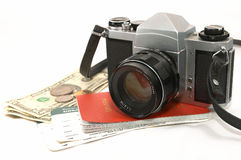 Seasoned Traveller. A layout of items showing old seasoned traveller, using a reliable mechanical camera, could be a photo journalist on a project, some money royalty free stock photos