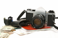 Seasoned Traveller. A layout of items showing old seasoned traveller, using a reliable mechanical camera, could be a photo journalist on a project, some money royalty free stock images