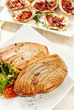 Seasoned Tuna Steaks and Gourmet Oysters on Table Royalty Free Stock Images