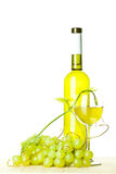 Seasoned wine and branch of green grapes Royalty Free Stock Photo