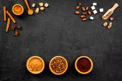 Seasoning for cooking desserts. Cinnamon, cocoa, badian on black background top view space for text. Seasoning for cooking desserts. Cinnamon, cocoa, badian on stock photography