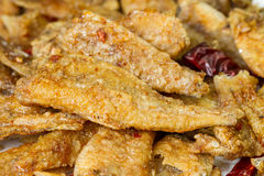 Seasoning crispy fried fish Royalty Free Stock Photography
