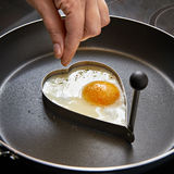 Seasoning for fried eggs in heart shape Royalty Free Stock Image